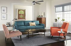 """Cole Chair & Ottoman modern living room"" -- Still trying to decide if I like the color combination, but the sofa would certainly go nicely in a peacock-accented room."