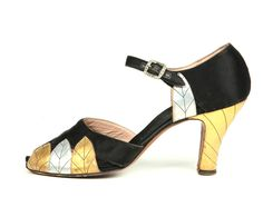 Black satin upper shoes, decorated with gold and silver leaves on the vamp and back and gold heels. USA. c. 1927-29. #vintage #1920s #shoes