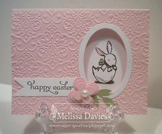 hand crafted Easter card ... Everybunny created by Melissa Davies @ rubberfunatics ... pink damask textured cover with negative space oval ... cute bunny image shows from inside ... ike the three part montage layout ... pretty card ...