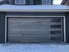 Planks style garage door in Driftwood with right stacked windows.