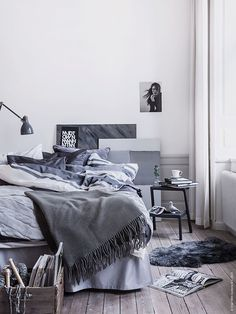 Shades-or-grey-and-blue-in-a-Scandinavian-bedroom.jpg