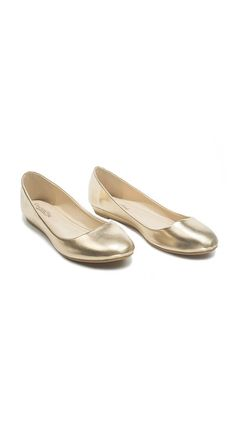 """Shine bright for all the holiday parties this season in this super comfortable mini wedge! The 0.5"""" heel and cushioned insole means these are a breeze to walk (or dance) in all day and night long! The glam metallic gold finish or the sophisticated black faux suede make these the perfect finishing touch to your outfit! You'l need one in each colour!"""