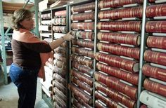 County Clerk Glenna Craig shows how many of the old county records are stored. She is gradually archiving them and would like to improve the storage area to better protect the fragile documents.