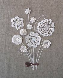 Quadro com flores em crochê