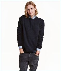 Knit sweater in a wool blend with ribbing at neckline, cuffs, and hem.