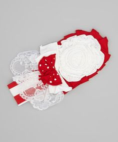 With a bow, lace and oodles of ruffles, this stretchy cotton headband is a deliciously sweet treat for a little buttercup's wardrobe.