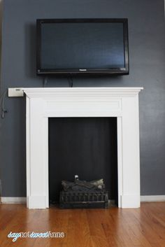 DIY Easy & Removable Fireplace - Create a beautiful and believable fireplace on the cheap. Moving? Take it with you!   Saynotsweetanne.com   #diy #renovation #fireplace #apartment