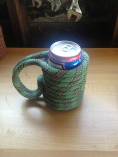soda can cozy made with climbing rope and superglue. SO COOL.