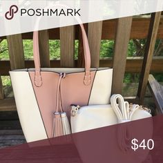 🎀Flash Sale🎀 NWT Reversible Tote &Bonus Very pretty shade of mauve pink and cream on one side and cream on the other of this reversible bag. Super cute tassels that are out regardless of whether you reverse it. This includes a smaller, matching cream bag that has an optional strap for use as a Crossbody. The smaller bag will also fit inside of the Tote for improved organization. The material is a faux Leather, vinyl type. Imoshion Bags