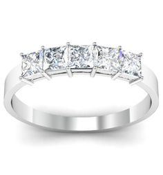 5 stone engagement ring with princess cut diamonds set in 14kt white gold.