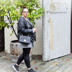 Stay casual chic with a leather jacket and sneakers! We love how Instagram user @plussize_crush styled this monochrome outfit! #OwnYourCurves
