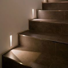 Lighting for the home illuminate the staircase leading to - Interior stair lighting ideas ...