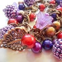 Copper Charm Bracelet Vintage style berry charm bracelet in purple, red, gold and copper    https://www.facebook.com/bedeckedbeads