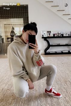 Kylie Jenner wearing Fan Merchandise Saint Pablo Tour Hoodie, Revenge x Storm orginals Lightning Bolt Sneakers