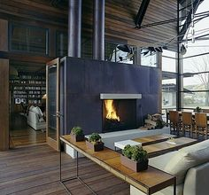 I like this open industrial space.  The fireplace makes quite a statement and acts as a space divider as well.