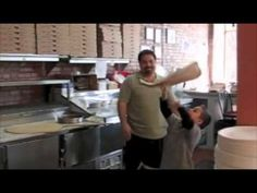 Little Michael Testa from Jersey City can toss a pizza just like his father Carmine, owner of Carmine's Pizza Factory in Jersey City.