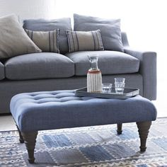 "BLOOMER FOOTSTOOL ""Bloomin' marvellous!"" is how our Long Eaton upholsterers described this buttoned footstool."
