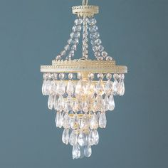 "Tiers of crystals drip from a cottage cream perforated filigree frame. Inspired by our popular antique wedding cake chandelier, this lantern combines glisten with a shabby elegance and is just the right size for lower ceilings or small powder rooms. 100 watts. (medium base socket)(19""Hx11""W)6' chain5"" canopy"