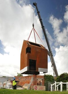 prefab metal home placed into a rubble of brick. Extremely cool!
