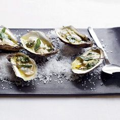 Grilled Oysters with Spiced Tequila Butter | Chef Blaine Wetzel grills oysters, then drizzles them with butter flavored with sage, oregano, lemon juice and tequila.