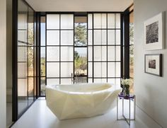 Designer: Kendall Wilkinson Fabulous onyx tub in a light filled master bath.