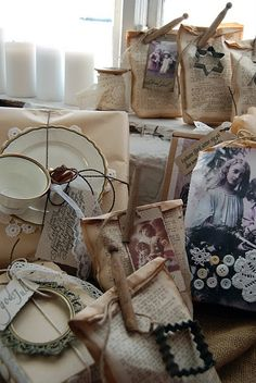Clever idea for wrapping packages with vintage book pages and old-fashioned clothes pins.  @ Cici Absolutely white via  Vania Morris