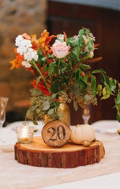 9 Ways to Create Stunning Fall Wedding Centerpieces---Squash, Gourd And Pumpkin Wedding Centrepieces for ructic weddings, wooden table numbers with floral diy reception decorations Fall Wedding Centerpieces, Rustic Wedding Centerpieces, Wedding Table Centerpieces, Wedding Table Numbers, Wedding Rustic, Diy Wedding, Autumn Wedding Decorations, Autumn Wedding Flowers, Centerpiece Ideas