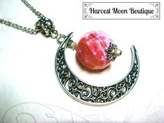 """This necklace was handcrafted by me. I used a silver plated filigree crescent moon charm and added silver plated stardust spacer beads and a beautiful faceted pink dragon vein agate bead. The pendant hangs almost 2.5"""" and comes on your size of antique silver plated link chain."""