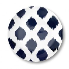 Design Tip:  Swap out basic white plates for a trendy ikat to dress up your table!