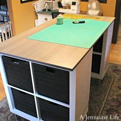Craft Table: 5 Creative Ways to Make Your Own - Black vinyl woven baskets and a wood-look tabletop give this craft table plenty of style. This one is also made from items found at Ikea. Stylish Ikea Craft Table Tutorial