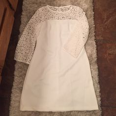 Lace illusion neck dress White scuba dress with lace neck and sleeves. Key hole at the back and hidden zipper. Dresses