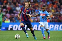 Ivan Rakitic (L) of FC Barcelona in action against Lorenzo Insigne of SSC Napoli during the pre-season friendly match between FC Barcelona and SSC Napoli on August 6, 2014 in Geneva, Switzerland.
