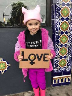 A San Francisco kid poses with the sign she made for the San Francisco Women's March on Jan. 21, 2017 Photo: Dionne