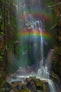Cast your eyes upon the double rainbow with the outpouring tearful waterfall flowing with His touch of grace and joy.  As the joy pours downward, it overflows ones mind with graceful thoughts, each rock represents a moment in time.  His unconditional love, just see, wait briefly and believe.
