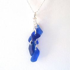 This elegant necklace is made with 5 pieces of authentic sea glass in cobalt blue (rare). The sterling silver figure eight chain measures 18 and has a 2 extension, so the total length can be adjusted up to 20 as the wearer prefers. The cascade hangs 1 1/2 inches in length from the chain. Sea glass takes about 30-60 years to form naturally in the ocean. Most glass found in the USA dates from the 1800s to the 1960s. It starts as wine bottles, dishware, art glass, windows, canning jars, i...