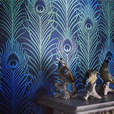 """'Birds of a feather flock together. My midnight blue peacock feather wallpaper for @osborneandlittle"""" Image capturing the magnificent peacock wallpaper by Matthew Williamson"""