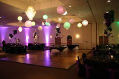 Purple and Green Lighted Lanterns over the dance floor at a Masquerade Prom at Maneeley's Ballroom in South Windsor, CT.