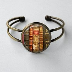 Antique style bronze cuff bracelet with art print sealed under glass.    Measurements are about 2.5 x 2.5 inches (63.5 mm). The image itself