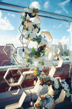 Honeycomb timber, flowers and lighting combine to create this incredible decor piece / backdrop.  Styled by The Style Co.