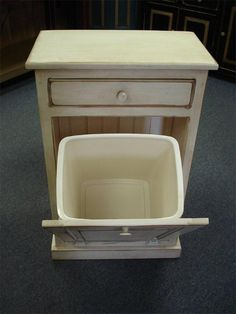 """Amish Tilt Out Trash Bin Cabinet with Drawerhttp://www.dutchcrafters.com/Amish-Tilt-Out-Trash-Bin-Cabinet/p/2446 Trash Bin Dimensions: Width: 21.5"""" Depth: 13"""" Height: 34""""  Wood: Pine Wood   Finish Options: Paint (white) -   Trash Can Size: Comes with 8 Gallon Trash Can $239.98"""