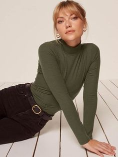 The Bridgette Top is part of the Reformation Jeans collection. This is a tight fitting, turtleneck top with long sleeves.