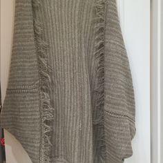 Frayed gray hem poncho NWOT. Oversized shrug cardigan. Frayed gray hem poncho. Bought from Three Bird Nest Three Bird Nest Sweaters Shrugs & Ponchos