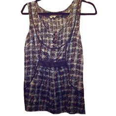 Anthropologie Plaid Shell Black & blue plaid shell top by Odille, sold at Anthropologie. Buttons down the front and black piping create a flattering look, and zipper up the side allows it to go on easily! Official size 2, fits sizes 2-4. Anthropologie Tops