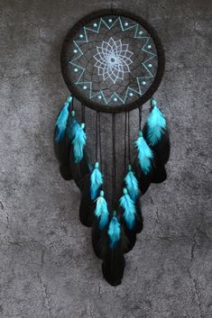 Just look at this stunning black dream catcher with turquoise blue feathers and gemstones Perfect for a cozy bedroom creative space or a chic dorm room An especially generous gift for someone Handmade with positive thoughts Dream Catcher Bedroom, Dream Catcher Decor, Black Dream Catcher, Beautiful Dream Catchers, Dream Catcher Boho, Making Dream Catchers, Large Dream Catcher, Turquoise Birthstone, Chic Dorm