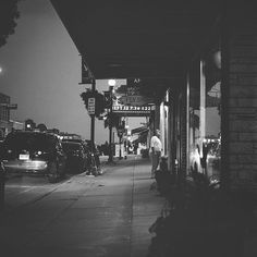 Downtown Viroqua Wisconsin.  Tonight I decided to do a little observing of downtown Viroqua nightlife. Sometimes just the simple act of sitting on a street bench and observing the people around you becomes the most interesting form of entertainment. It's like reality TV but without the Kardashians and the script is written in your head.  Black and white shot with my Canon 5D MKII and my nifty fifty.  #viroqua #viroquawi #blackandwhite #flyshop #vsco #vscocam #vscogrid #vscogood…