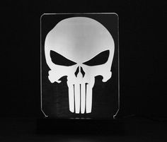 The design is a fan made ~ The Punisher Skull  SIGNS ====== *Sign measures approximately 6 wide by 7 tall. *Made with Premium Grade, 1/4 thick, Acrylic. *Engraved and cut with a Commercial Grade, 60 Watt, Laser Engraver. *Our unique design is made with notches on the side of the Acrylic, so sign doesnt rest on the led light strip.  BASES ====== *Made from premium hard wood and have an accent trim ring that also illuminates with ...
