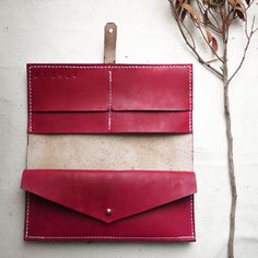 Sleek and stylish. This functional Bi-fold purse is made from a high graded natural vegetable tanned leather, hand dyed and hand stitched using waxed linen thread. Many compartments for cards, coins, notes and even a small mobile device. Hand cut, hand dyed, finished and polished in a weather proof conditioning cream. Purse is fastened with Sam Brown studs. Choose between Silver and brass studs. The natural properties of the veg tan leather means this purse will age and darken to develop ...
