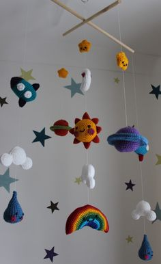 Mobile for the baby's room with a mash-up of three different patterns! Sun, plan… Mobile for the baby's room with a mash-up of three different patterns! Sun, planets, rainbow, rockets and raindrops all with happy smiley faces. Crochet Baby Mobiles, Crochet Mobile, Crochet Baby Toys, Crochet Diy, Crochet Amigurumi, Amigurumi Patterns, Crochet For Kids, Crochet Crafts, Baby Knitting