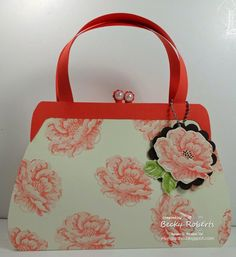 """Purses, Lots of Paper Purses - So pretty in Calypso Coral with Stipples Blossoms stamp set.  This purse holds full size, 5-1/2"""" x 4-1/4"""" cards.  It will hold 4 cards and envelopes and makes a lovely gift packaging.  You can find the tutorial for this in the 12 Days of Christmas 2010 edition.  (It is shown in Christmas paper.)"""