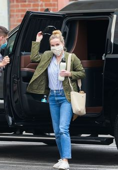 Reese Witherspoon casual outfit - jacket, shirt, jeans and sneakers | For more style inspiration visit 40plusstyle.com